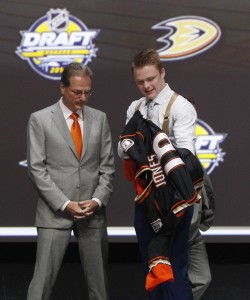 Jun 24, 2016; Buffalo, NY, USA; Max Jones puts on a team jersey after being selected as the number twenty-four overall draft pick by the Anaheim Ducks in the first round of the 2016 NHL Draft at the First Niagra Center. Mandatory Credit: Timothy T. Ludwig-USA TODAY Sports