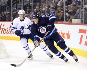 Oct 19, 2016; Winnipeg, Manitoba, CAN; Toronto Maple Leafs center Auston Matthews (34) chases Winnipeg Jets right wing Patrik Laine (29) during the third period at MTS Centre. Winnipeg won 5-4 in overtime. Mandatory Credit: Bruce Fedyck-USA TODAY Sports