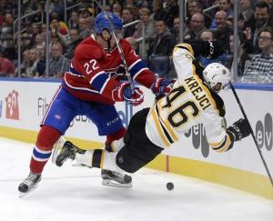 Oct 4, 2016; Quebec City, Quebec, CAN; Montreal Canadiens defenseman Mikhail Sergachev (22) checks Boston Bruins forward David Krejci (46) during the third period of a preseason hockey game at Centre Videotron. Mandatory Credit: Eric Bolte-USA TODAY Sports