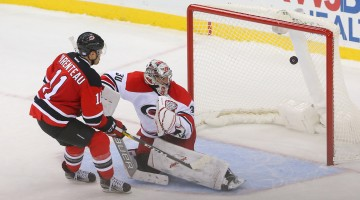 Nov 8, 2016; Newark, NJ, USA; New Jersey Devils right wing PA Parenteau (11) scores a goal on Carolina Hurricanes goalie Cam Ward (30) during the shootout at Prudential Center. The Devils defeated the Hurricanes 3-2 in a shootout. Mandatory Credit: Ed Mulholland-USA TODAY Sports