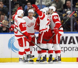 Nov 23, 2016; Buffalo, NY, USA;Detroit Red Wings right wing Gustav Nyquist (14) celebrates with teammates after scoring a goal against the Buffalo Sabres during the second period at KeyBank Center. Mandatory Credit: Kevin Hoffman-USA TODAY Sports