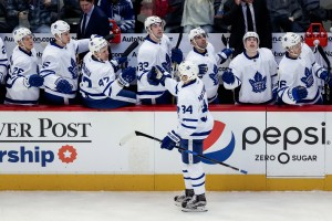 Dec 22, 2016; Denver, CO, USA; Toronto Maple Leafs center Auston Matthews (34) celebrates with teammates after scoring a goal in the first period against the Colorado Avalanche at the Pepsi Center. Mandatory Credit: Isaiah J. Downing-USA TODAY Sports