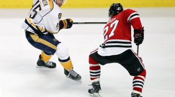 Apr 13, 2017; Chicago, IL, USA; Nashville Predators center Craig Smith (15)battles for the puck with Chicago Blackhawks defenseman Johnny Oduya (27) during the third period in game one of the first round of the 2017 Stanley Cup Playoffs at United Center. Mandatory Credit: Kamil Krzaczynski-USA TODAY Sports