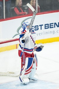 Mar 18, 2017; Saint Paul, MN, USA; New York Rangers goalie Antti Raanta (32) celebrates following the game against the Minnesota Wild at Xcel Energy Center. The Rangers defeated the Wild 3-2. Mandatory Credit: Brace Hemmelgarn-USA TODAY Sports